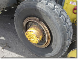 One wheel from a dual multi piece wheel fitted to an excavator